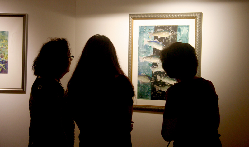 Visitors view artwork at Aqueous 2018.
