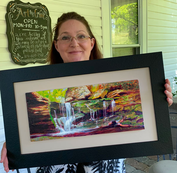"Katherine Crim with her watercolor ""Elekala Falls."""