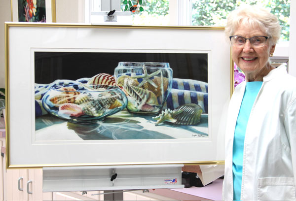 "Ardyth Jolliff with her watercolor ""Collection Reflections."""